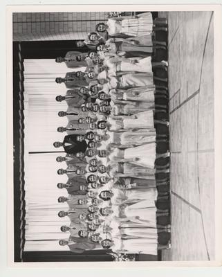 The Glee Club under the direction of Robert Knauf (top row center)