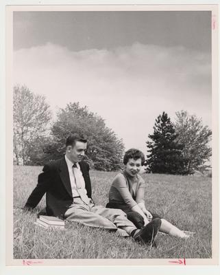 Devou Park; John Whitt and Billie Rose Lambert enjoy a beautiful day while seated in the grass