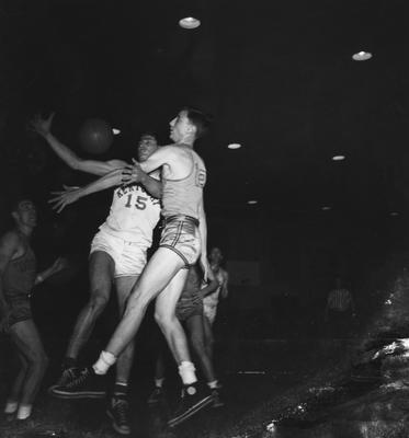 Basketball game action, versus Vanderbilt. Pictured is Alex Groza fighting for the ball