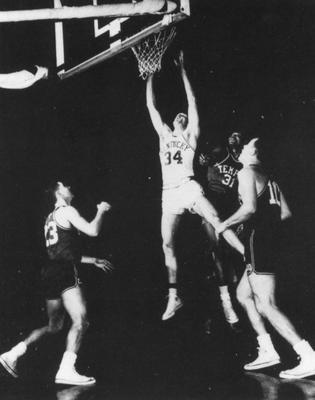 Basketball game action, UK versus Temple; Ed Beck takes a shot for a goal; photo appears on page 206 in the 1958 Kentuckian