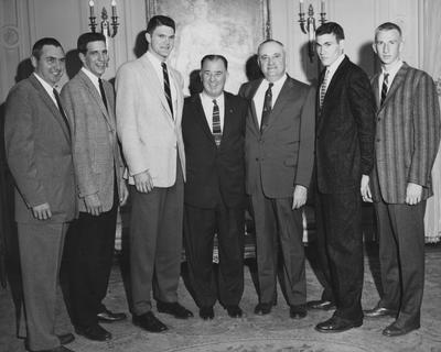 Basketball team members, 1958 championship season, (left to right) unidentified, Bill Lickert, Ed Beck, Governor A. B.