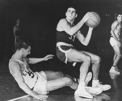 Basketball game action; unidentified player takes a shot against UK; Dick Parsons falling to the floor, left; Lexington Herald-Leader staff photo
