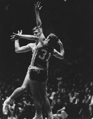 Basketball game action; unidentified UK player passing the ball; photo appears on page 88 in the 1969 Kentuckian