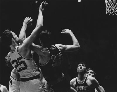 Basketball game action, UK versus Auburn; Larry Steele (25) shoots as other unidentified UK player watches; photo appears on page 386 in the 1969 Kentuckian