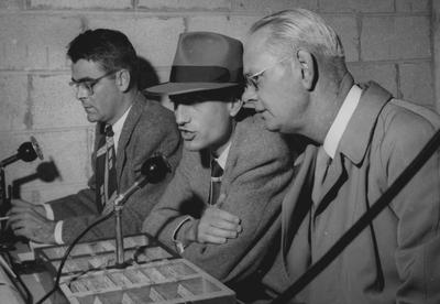 Ben Williams, J. B. Faulconer, 1939 journalism graduate and creator of first UK sports information and broadcast network, and Bernie Shively (left to right), UK Athletics Director, pictured in press box during game; photo received May 5, 1965 from the Lexington Herald-Leader