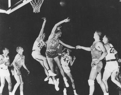 Basketball game action, UK versus Georgia Tech; pictured are Bill Evans (42), Phil Grawemeyer (44), Jerry Bird (22), and Bob Burrows (50), from the 1954-55 season; photo appears on page 134 in the 1955 Kentuckian