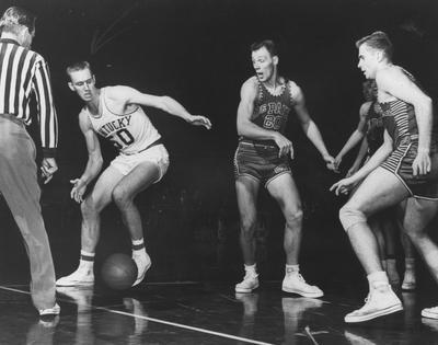 Basketball game action, UK versus DePaul; pictured is Bob Burrows dribbling around defenders
