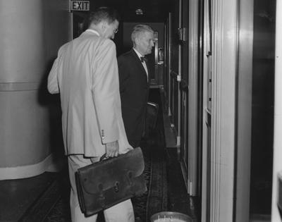 Albert Kirwan, chairman of the NCAA infractions committee, with Art Bergstrom, investigator; Lexington Herald-Leader staff photo