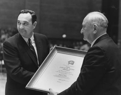 Governor Louis B. Nunn (1967-71) presents basketball coach Adolph Rupp the Louis B. Nunn Award