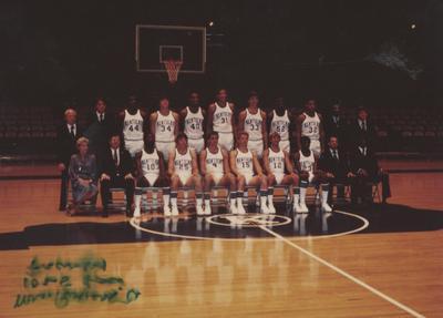 UK Men's Basketball team, December 1979; seated far left, Jane S. Rollins, to her left, coach Joe B. Hall