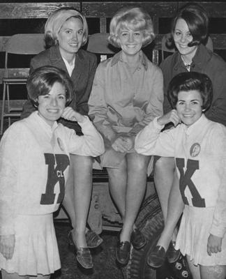Two unidentified cheerleaders and three unidentified students, all homecoming queen finalists