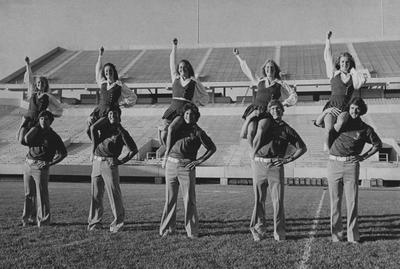 Five unidentified male and female cheerleaders at Commonwealth Stadium
