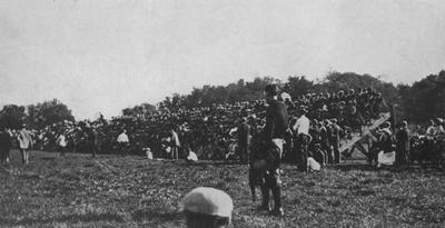 Unidentified people watching a football game. Photo appears on page 123 in the 1912 Kentuckian