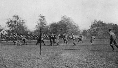 Unidentified students playing football at the Senior - Junior class game. Photo appears on page 159 in the 1912 Kentuckian