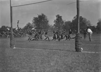 Unidentified football players in a game against the University of Louisville, in Lexington. Photo appeared August 30, 1967 in the Kentucky Kernel