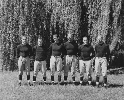 UK football coaching staff, 1931; left to right, Lloyd Ramsey, Frank Moseley, Albert (Ab) Kirwan, Bernie Shively, Gene Myers, and Joe Rupert; photographer:  Lafayette Studios, Lexington