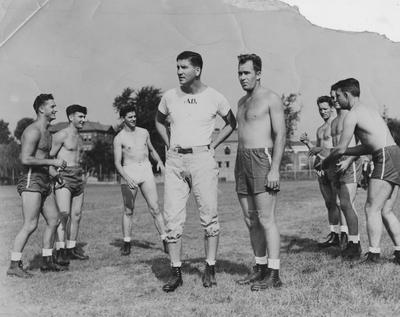 Albert D. (Ab) Kirwan as coach of the UK football team, talking with captain Joe Shepherd, with other players