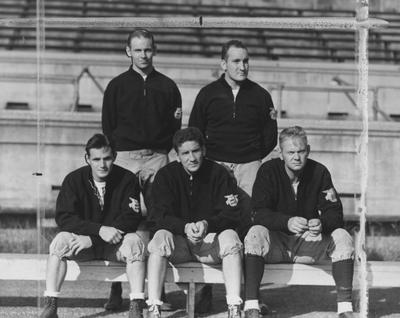UK football coaching staff, (top row,left to right) Joe Rupert, Gene Myers, (bottom row, left to right) Frank Moseley, Ab Kirwan (head coach), and Bernie Shively (Athletics Director and line coach), 1939; photo appears in the Cincinnati Enquirer with caption reading