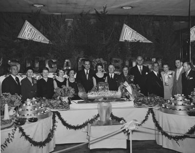 Celebration dinner after UK victory over Oklahoma in the Sugar Bowl, New Year's Day, 1951; pictured from right, Charles Grenrod, Ab Kirwan, Betty Kirwan, Governor A. B. Chandler, Athletics Director Bernie Shively, Mrs. Chandler, UK President Herman Donovan; others are unidentified; photographer:  Leon Price Picture Service