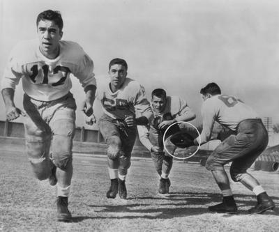 Four members of UK football team, (left to right) Larry Jones, Harry Jones, Bill Leskovar, and quarterback Vito