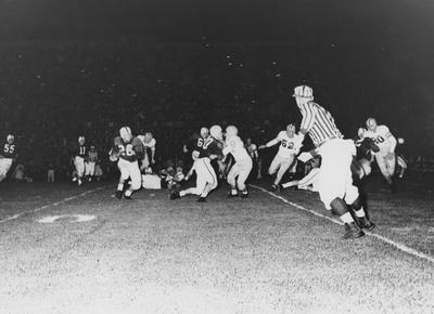 Unidentified football players during game against Louisiana State University