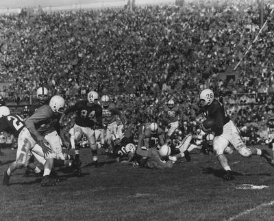Unidentified football players during game against unidentified opponent; photographer:  University of Kentucky