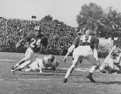 Dicky Lyons (24) carrying the ball against Ole Miss
