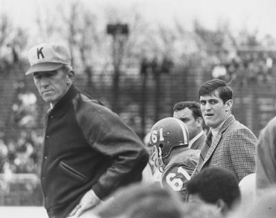 Head football coach Charlie Bradshaw (1962-68, at left, wearing hat) and other unidentified individuals. Photo appears on page 219 in the 1969 Kentuckian