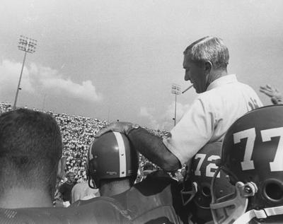 Head football coach Charlie Bradshaw (1962-68) with unidentified UK football players. Photo appears on page 213 in the 1969 Kentuckian