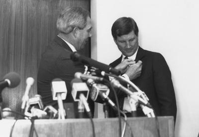 Athletics Director C. M. Newton (left) introduces Bill Curry as the head coach