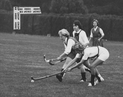 Unidentified Eastern State College field hockey takes the ball from Barbara Brookhart during game near Stoll Field; photo appears on page 174 in the 1963 Kentuckian