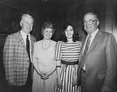 Harry Lancaster, former assistant basketball coach and former Athletics Director, pictured standing with three unidentified people
