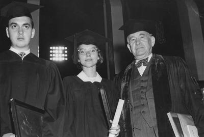 Three award winners at the 82nd UK commencement; pictured left to right are Charles Whaley and Mary Sue McWhirter, Outstanding Man and Women of the 1949 graduating class, and Vice President Albin W. Barkley, Sullivan Medallion recipient, June 6, 1949. Received June 13, 1959 from Cincinnati Enquirer