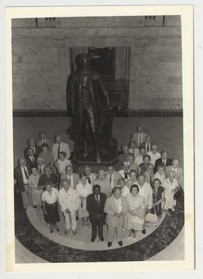 Donovan Scholars, including an unidentified African - American, stand at the Capital Rotunda in Frankfort