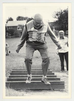 A male Donovan Scholar performs an exercise led by Bernard