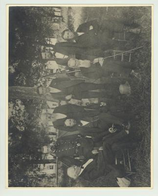 According to the Reference Archivist, this print is the oldest print of the University faculty; Seated, from left to right: Dr. Robert Peter, Physics and Chemistry; President James K. Patterson; unidentified; Professor John Shackleford, professor of English Literature, 1880 - 1889; Standing: Major E. Denning Luxton, commandant of cadets; Professor Francois Helveti, Romance Languages; John A. Dean, superintendent of farm; Professor James G. White, Mathematics, 1869 - 1913, acting President of A & M College, 1910 - 1911
