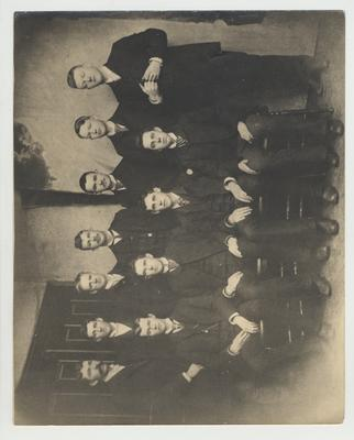 A group of men including Alfred Gay (b. 1871 - d. 1936), who was an assistant in the Academy 1906 - 1911 and listed in the 1887 Board of Trustees minutes
