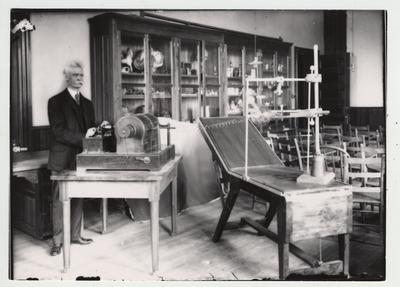 Faculty member Joseph Pryor, shown here, and Merry Pence, together built this early x - ray machine