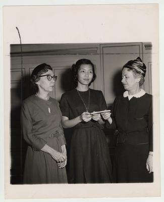 A scholarship is awarded to May H. M. Yang, a Library Science student, by the Altrusa Club (a Lexington Service Club for business women); From left to right are: Dr. Jacqueline P. Bull, Yang, and Robin Lowry, president of the club