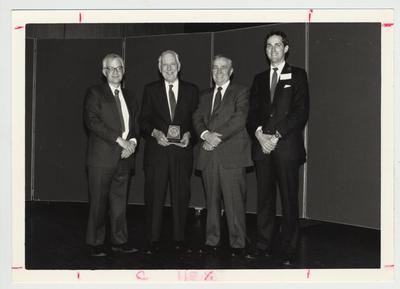 Dr. Thomas D. Clark is awarded the first Library Medallion, given by the Library Association friends and benefactors of the library; From left to right: Paul Willis, Thomas D. Clark, Boyton Morrill, and Tom Van Meter