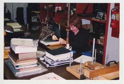 An unidentified woman works in the King Library Press which is located in the basement of King Library