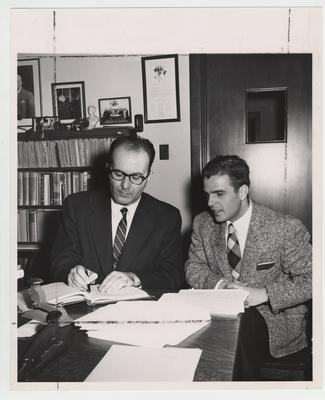 Turkish librarian Mehmet Muzaffer Gobman, director of Beyazit Public Library Istanbul, Turkey (left) and interpreter Ali Arman (right) in Dr. Thompson's office; Lexington Herald - Leader staff photo