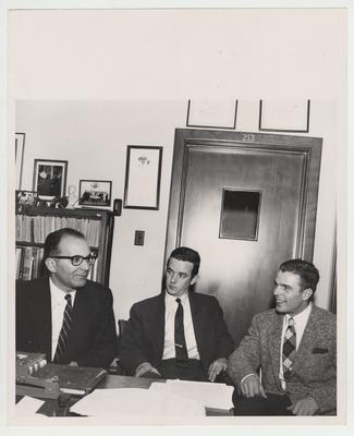 Turkish librarian Mehmet Muzaffer Gobman, director of Beyazit Public Library Istanbul, Turkey (left), Jim Gribble (center), and interpreter Ali Arman (right) in Dr. Thompson's office