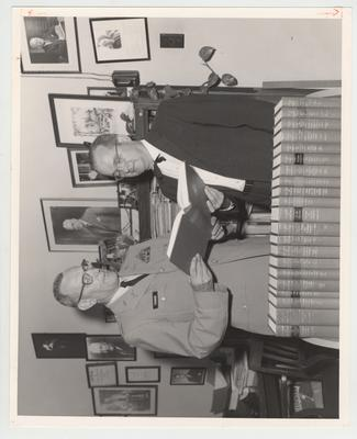 Commandant Robert E. Tucker presents books from the Army to Director of Libraries Lawrence S. Thompson