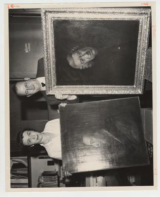 Dr. Lawrence S. Thompson, Director of University of Kentucky Libraries, and his secretary Mary G. Edwards, add two portraits, one of Dr. Samuel Johnson and one of Alexander Pope, which were donated by Philip D. Snag, River Forest, Illinois; The portraits were painted in the studios of Sir Joshua Reynolds, famous 18th century artist