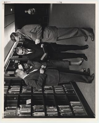 From left to right: Lawrence Thompson, Director of Libraries (left) and President Frank Dickey (right), with an unidentified man and woman; Photographer: R. R. Rodney Boyce