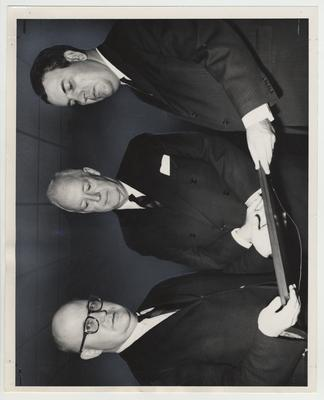 Two letters written by Isaac Shelby, Kentucky's first governor, are presented by his great - great - grandson, William Campbell Scott (center), a University of Kentucky alumnus, to the Shelby collection of the University of Kentucky Library; Accepting are Dr. Stuart Forth, Director of the UK Libraries, and Charles Atcher, UK Library Field Representative