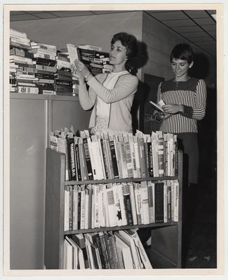 University of Kentucky Library staffers Loraine Noel (left) and Judy Boston, begin classification of the library's new books purchased under the Automatic Book Acquisition Program; Photographer: Kalman Papp
