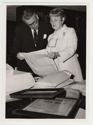 Charles Atcher, University of Kentucky Archivist, with Mrs. George P. Johns, descendent of Kentucky Senator Sam Haycraft, who is donating papers of Senator Haycraft to the library