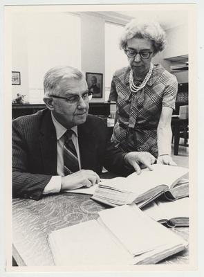 Dr. Ellis F. Hartford, University of Kentucky professor of education, gets help from Dr. Jacqueline Bull, who is in charge of Special Collections at the University of Kentucky's Margaret I. King Library; Dr. Hartford is preparing a two - volume history of education in Kentucky